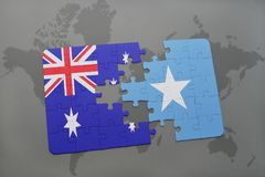 Puzzle with the national flag of australia and somalia on a world map background. Stock Images