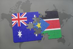 Puzzle with the national flag of australia and south sudan on a world map background. Royalty Free Stock Photography