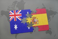 puzzle with the national flag of australia and spain on a world map background. Royalty Free Stock Photos
