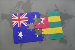 Puzzle with the national flag of australia and togo on a world map background. Stock Image