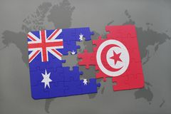Puzzle with the national flag of australia and tunisia on a world map background. Stock Image