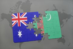 Puzzle with the national flag of australia and turkmenistan on a world map background. Royalty Free Stock Photo