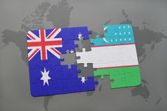 Puzzle with the national flag of australia and uzbekistan on a world map background. Stock Photos