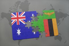Puzzle with the national flag of australia and zambia on a world map background. Royalty Free Stock Image