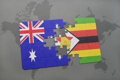 Puzzle with the national flag of australia and zimbabwe on a world map background. Royalty Free Stock Photography