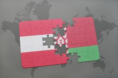 puzzle with the national flag of austria and belarus on a world map background. Stock Photo
