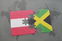 Puzzle with the national flag of austria and jamaica on a world map background. 3D illustration royalty free stock image