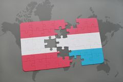 puzzle with the national flag of austria and luxembourg on a world map background. Royalty Free Stock Photo