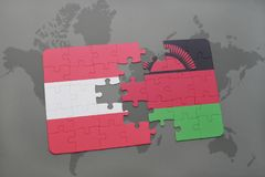Puzzle with the national flag of austria and malawi on a world map background. 3D illustration Stock Photos