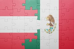 Puzzle with the national flag of austria and mexico. Concept stock photos