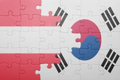 Puzzle with the national flag of austria and south korea. Concept royalty free stock image