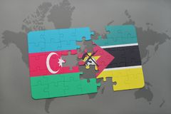 Puzzle with the national flag of azerbaijan and mozambique on a world map. Background. 3D illustration Royalty Free Stock Photos