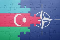 Puzzle with the national flag of azerbaijan and nato. Concept stock image