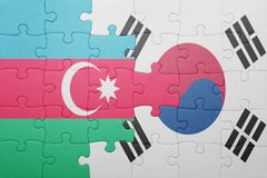 Puzzle with the national flag of azerbaijan and south korea. Concept royalty free stock photos