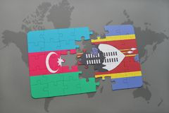 Puzzle with the national flag of azerbaijan and swaziland on a world map Royalty Free Stock Image
