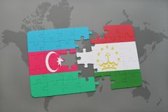 puzzle with the national flag of azerbaijan and tajikistan on a world map Royalty Free Stock Photo