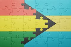 Puzzle with the national flag of bahamas and bolivia Stock Photography