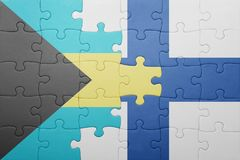 Puzzle with the national flag of bahamas and finland Royalty Free Stock Photo