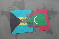 Puzzle with the national flag of bahamas and maldives on a world map. Background. 3D illustration Royalty Free Stock Photo