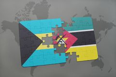 Puzzle with the national flag of bahamas and mozambique on a world map. Background. 3D illustration Royalty Free Stock Photo