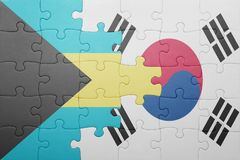 Puzzle with the national flag of bahamas and south korea. Concept stock photography