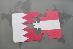 puzzle with the national flag of bahrain and austria on a world map background. Stock Photography