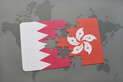 Puzzle with the national flag of bahrain and hong kong on a world map background. 3D illustration Stock Images