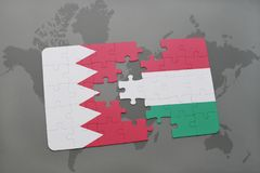 Puzzle with the national flag of bahrain and hungary on a world map background. Stock Images
