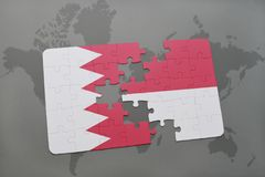 Puzzle with the national flag of bahrain and indonesia on a world map background. 3D illustration Stock Photos