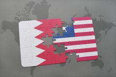 puzzle with the national flag of bahrain and liberia on a world map background. Royalty Free Stock Photo
