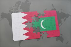 Puzzle with the national flag of bahrain and maldives on a world map background. 3D illustration Royalty Free Stock Image