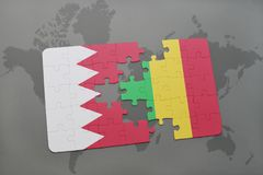 Puzzle with the national flag of bahrain and mali on a world map background. Royalty Free Stock Photo