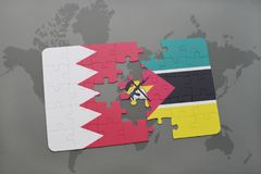Puzzle with the national flag of bahrain and mozambique on a world map background. Stock Photo