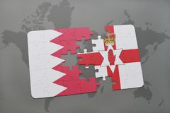 Puzzle with the national flag of bahrain and northern ireland on a world map background. 3D illustration Stock Photos