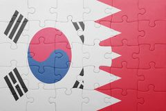 Puzzle with the national flag of bahrain and south korea. Concept stock photography
