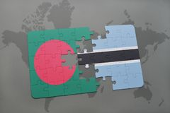 Puzzle with the national flag of bangladesh and botswana on a world map Royalty Free Stock Photography