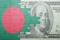Puzzle with the national flag of bangladesh and dollar banknote Stock Photos