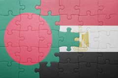 Puzzle with the national flag of bangladesh and egypt. Stock Image