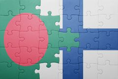 Puzzle with the national flag of bangladesh and finland Royalty Free Stock Photos