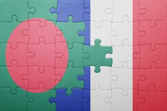 Puzzle with the national flag of bangladesh and france Royalty Free Stock Image