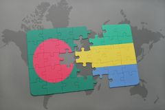 Puzzle with the national flag of bangladesh and gabon on a world map Royalty Free Stock Photos