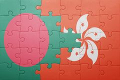 Puzzle with the national flag of bangladesh and hong kong Royalty Free Stock Photos