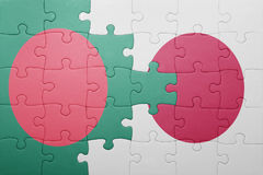 Puzzle with the national flag of bangladesh and japan Stock Photography