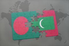 Puzzle with the national flag of bangladesh and maldives on a world map background. Royalty Free Stock Images