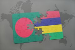 Puzzle with the national flag of bangladesh and mauritius on a world map Stock Images