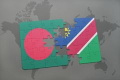 Puzzle with the national flag of bangladesh and namibia on a world map Stock Photo