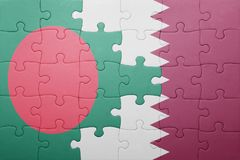 Puzzle with the national flag of bangladesh and qatar Royalty Free Stock Photo