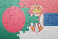 Puzzle with the national flag of bangladesh and serbia . concept Stock Photography