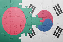 Puzzle with the national flag of bangladesh and south korea Stock Photos