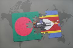 Puzzle with the national flag of bangladesh and swaziland on a world map Stock Images